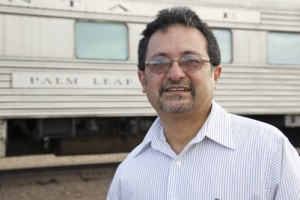 Frank X. Moraga hanging out next to a westbound California Zephyr in Winslow, AZ. Photo by Star Hunter / ©2014